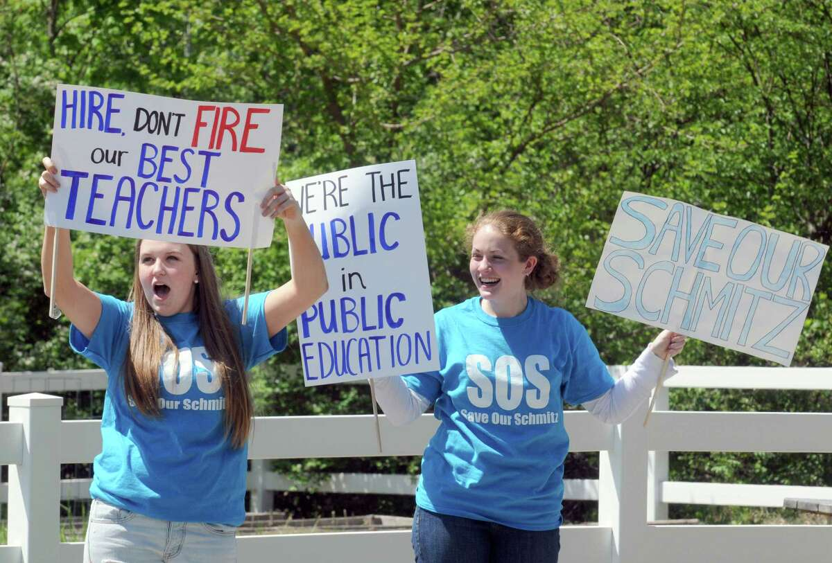 High School students Ellie Frantz, left, and Izzy Rutkey join other students and parents in protesting the proposed firing of Asstant High School Principal Laura Schmitz by the Ballston Spa School District on Thursday May 14, 2015 in Ballston Spa, N.Y. (Michael P. Farrell/Times Union)