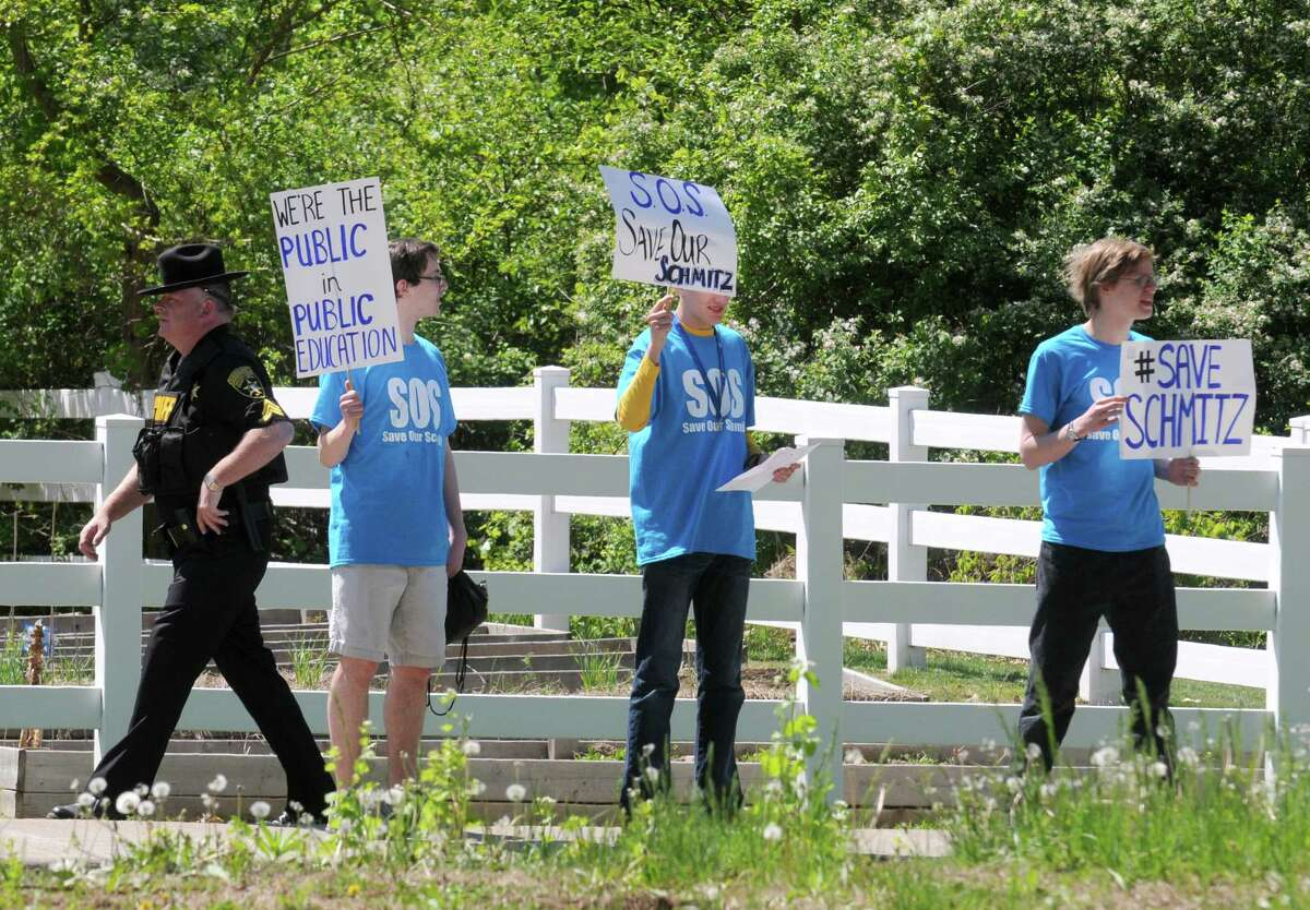 Parents and students protest the proposed firing of Asstant High School Principal Laura Schmitz by the Ballston Spa School District on Thursday May 14, 2015 in Ballston Spa, N.Y. (Michael P. Farrell/Times Union)