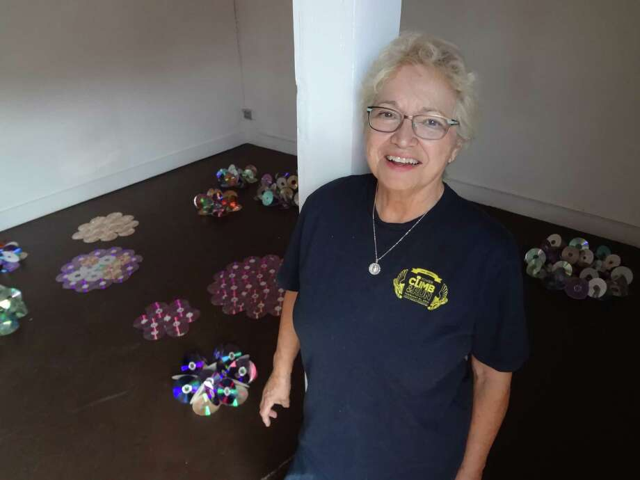 """Artist Anita Valencia has installed """"Lily Pads and Lotus Blossoms,"""" made of old CDs, at the Epitome Institute. Photo: Photos By Steve Bennett / San Antonio Express-News"""