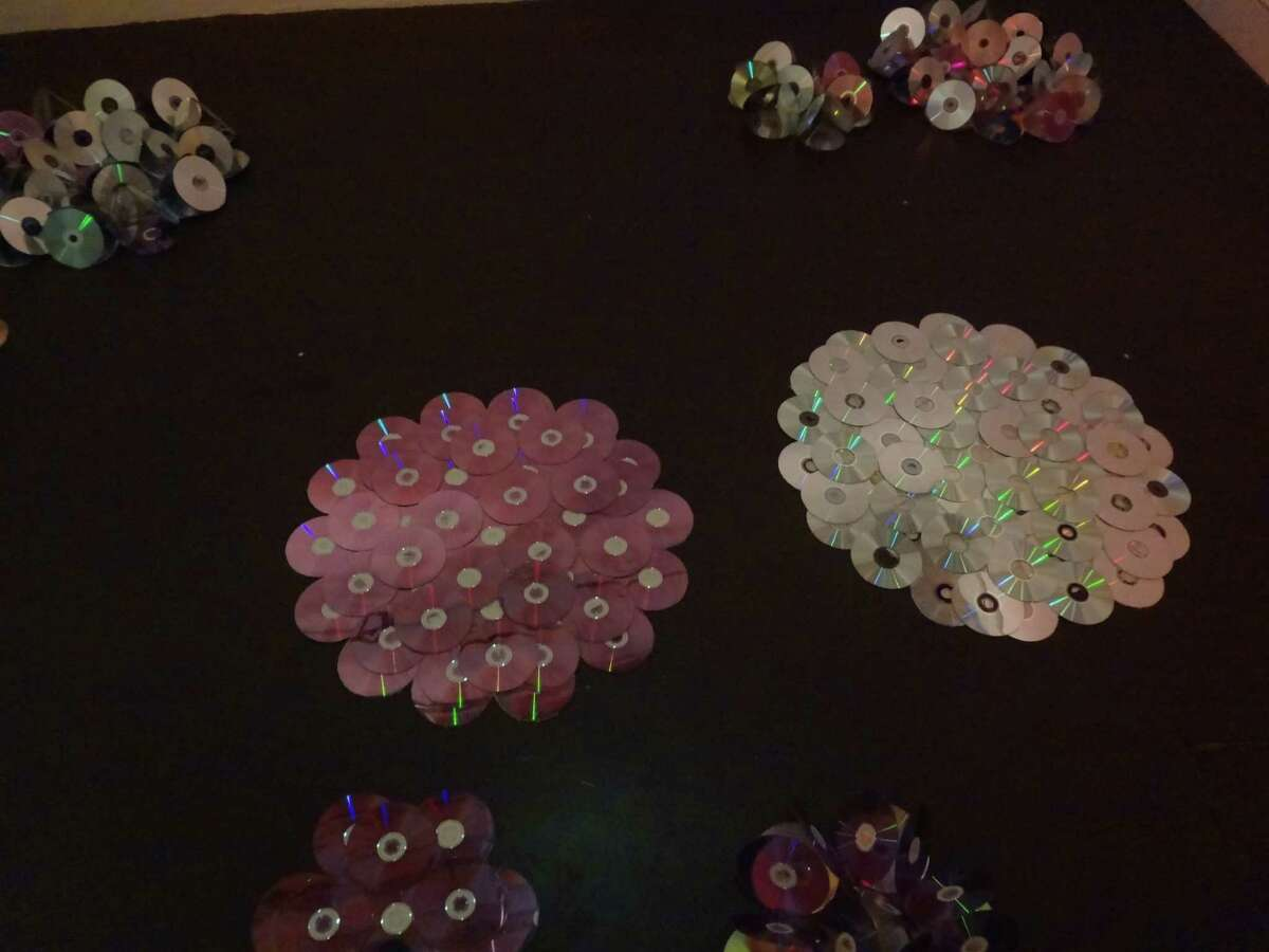 Artist Anita Valencia created lily pads out of used CDs.