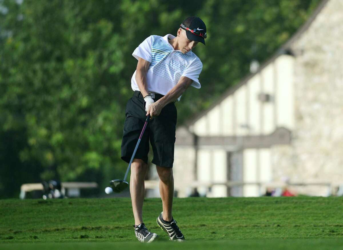 Andrew Kraemer tees off during the first round of the 56th Greater San Antonio Junior Championship at Brackenridge Park Golf Course on July 1, 2014.