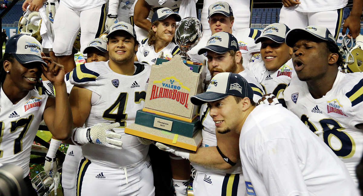Members of the UCLA Bruins celebrate after defeating the Kansas State Wildcats in the Valero Alamo Bowl Friday Jan. 2, 2015 at the Alamodome. UCLA won 40-35.
