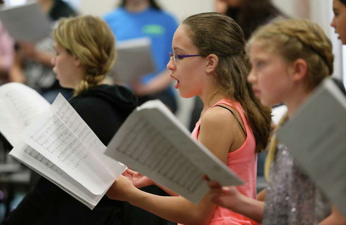 Members of the Children's Chorus of San Antonio rehearse on Tuesday, June 24, 2014, at Alamo Heights United Methodist Church in San Antonio. It was the second day of rehearsal for the chorus, which will perform September 14 as part of the opening of the Tobin Center for the Performing Arts.