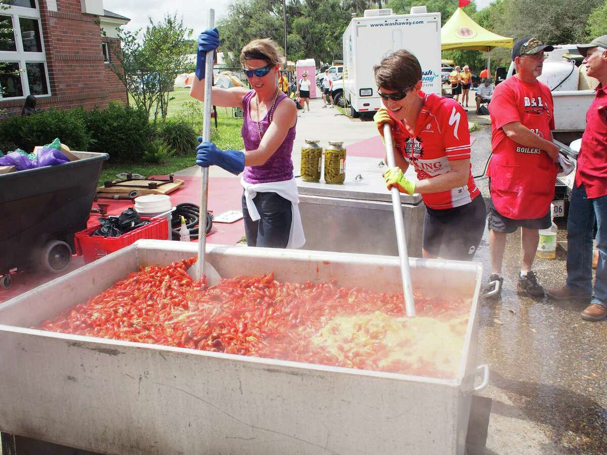 Gretch Sanders, left, and Pam LeBlanc, right, help cook up a batch of crawfish during Cycle Zydeco on April 27, 2015.