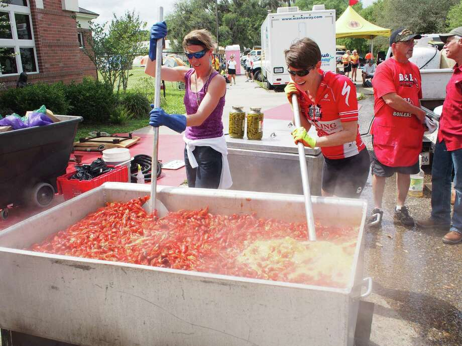 Gretch Sanders, left, and Pam LeBlanc, right, help cook up a batch of crawfish during Cycle Zydeco on April 27, 2015. Photo: Pam LeBlanc /TNS / Austin American-Statesman