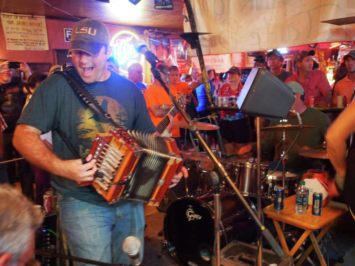 A zydeco band plays at Fred's Lounge in Mamou, La., during the Cycle Zydeco bike tour through Southern Louisiana. Fred's is only open from 9 a.m. until 2 p.m. Saturdays and is famous for its music.