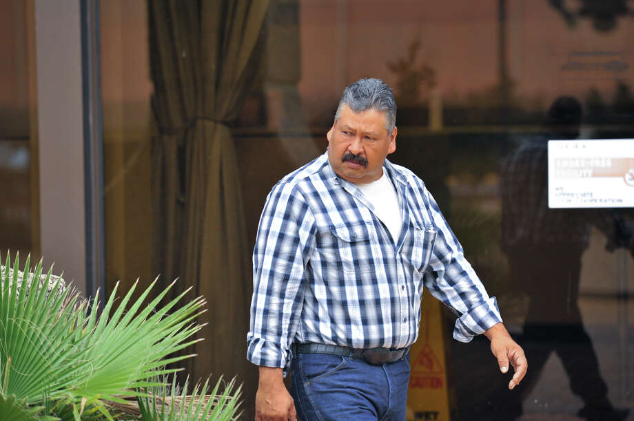 Jorge A. Rocha walks out of the U.S. Courthouse Thursday morning after pleading guilty to selling protected migratory birds to undercover officers. Photo: Robin Jerstad, Freelance / San Antonio Express-News