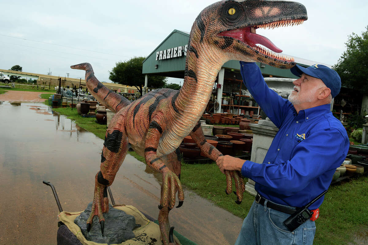 Frazier's Ornamental & Architectural Concrete in Hempstead is an unforgettable sight from the highway thanks to the giant dinosaur ornaments lining its grounds. Owner Billy Frazier can be seen here in May 2015.