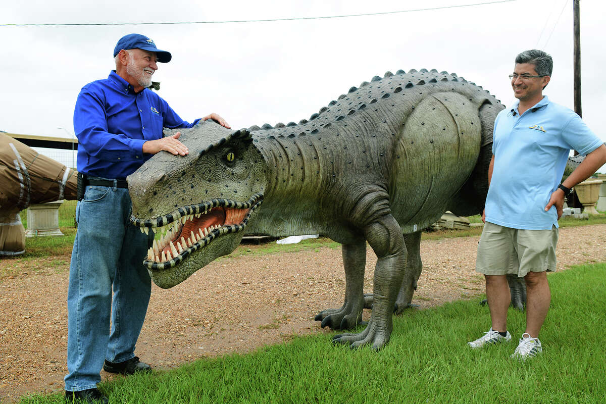 Frazier's Ornamental & Architectural Concrete in Hempstead is an unforgettable sight from the highway thanks to the giant dinosaur ornaments lining its grounds. Frazier andstepson, Fernando Gomez, who is the company's general manager, can be seen here in May 2015.