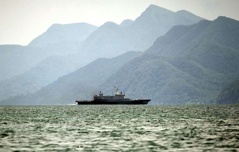 A Royal Malaysian Navy ship patrols along the Thai-Malaysia border looking for boats containing mostly Rohingya migrants from Bangladesh and Myanmar, near the coast of Langkawi island on May 14, 2015. Malaysia has turned away two vessels carrying a combined 600 migrants, according to an official who spoke on condition of anonymity on May 14, as concern mounted in the region over the fate of boatloads of people stranded at sea. Photo: Manan Vatsyayana /Getty Images / AFP
