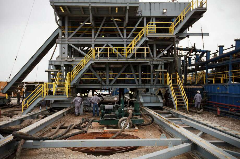 Drilling of multiple wells from a single temporary pad, underway here  in South Texas' Eagle Ford Shale, sometimes leaves wells drilled but not completed for production. Photo: MICHAEL STRAVATO, STR / NYTNS