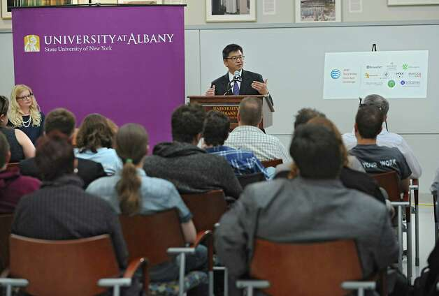 """Michael Shimazu, associate vice president business partnerships and economic development, University at Albany, speaks before AT&T announces winners of its $18,000 """"app challenge"""" for local developers at the University at Albany on Thursday, May 14, 2015 in Albany, N.Y. (Lori Van Buren / Times Union) Photo: Lori Van Buren / 10031848A"""