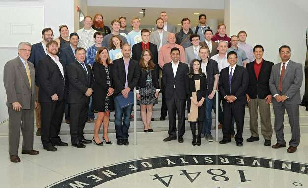 "Judges and winners including Food Pantry, Electorate, Snapmap, Project Hunt, Ant Hill and Eveny pose for a photo after AT&T announced the winners of its $18,000 ""app challenge"" for local developers at the University at Albany on Thursday, May 14, 2015 in Albany, N.Y. (Lori Van Buren / Times Union) Photo: Lori Van Buren / 10031848A"