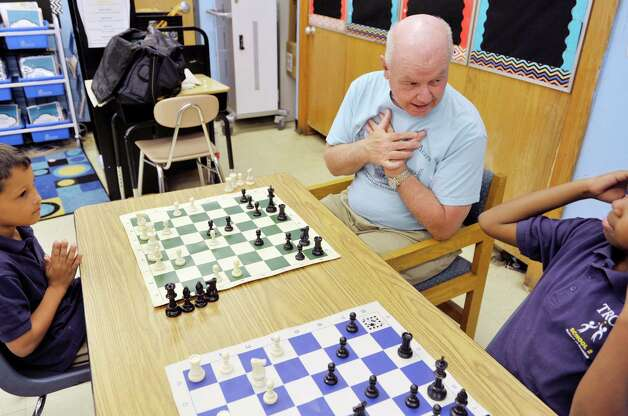John McManus with The Right Move teaches chess to students during a Project Based Learning program at Troy School 2 on Wednesday, May 13, 2015, in Troy, N.Y.  The program is a 6-week program that meets on Wednesday afternoons for Grades three through five.   (Paul Buckowski / Times Union) Photo: PAUL BUCKOWSKI / 00031786A