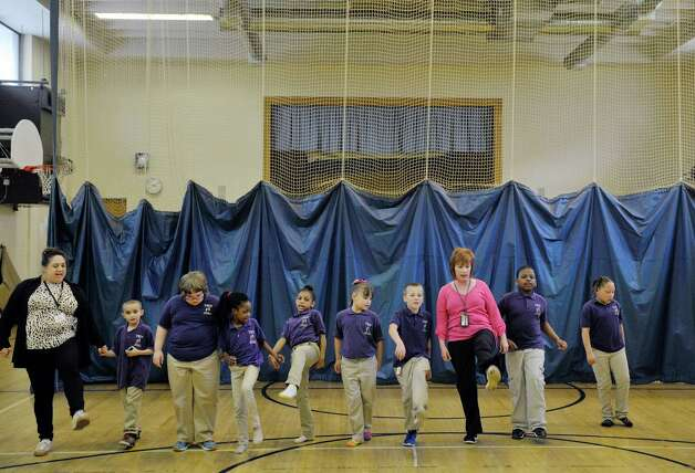 Students learn Irish step dance during a Project Based Learning program at Troy School 2 on Wednesday, May 13, 2015, in Troy, N.Y.  The program is a 6-week program that meets on Wednesday afternoons for Grades three through five.   (Paul Buckowski / Times Union) Photo: PAUL BUCKOWSKI / 00031786A