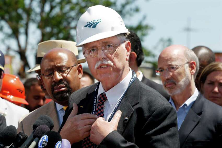 As Philadelphia Mayor Michael Nutter, left, and Pennsylvania Gov. Tom Wolf, right, listen Amtrak CEO, Joseph Boardman expresses his sorrow near the site of a deadly train derailment Thursday, May 14, 2015, in Philadelphia. An Amtrak train headed to New York City derailed and crashed in Philadelphia on Tuesday night killing eight people and and sending more than 200 passengers and crew to area hospitals. Investigators have said the Amtrak passenger train was going more than twice the allowed speed when it shot off a sharp curve. (AP Photo/Mel Evans) ORG XMIT: PAME112