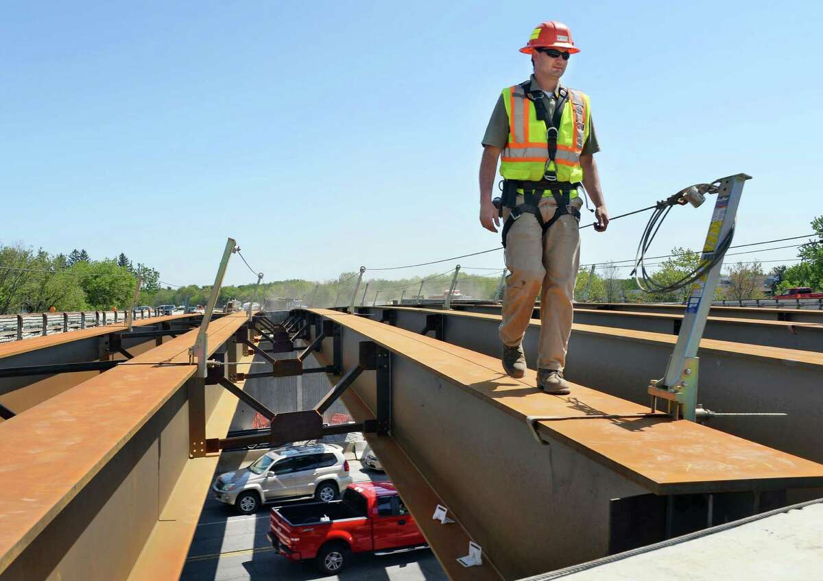 Chief inspector Luke Thompson of Creighton Manning walks over girders erected over night on the south bound bridge at the Northway Exit 4 construction project Thursday May 14, 2015 in Colonie, NY. (John Carl D'Annibale / Times Union archive)