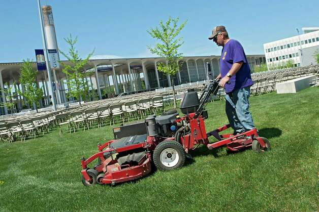 Grounds keeper Joe Wagner mows the lawn in preparation for this weekend's graduation ceremonies at the University at Albany on Thursday, May 14, 2015 in Albany, N.Y. (Lori Van Buren / Times Union) Photo: Lori Van Buren