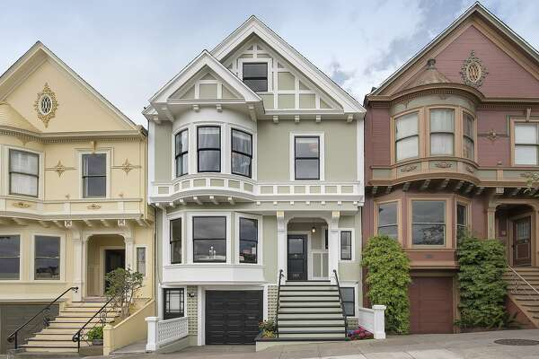 569 Ducobe Ave. is a Victorian row home with five bedrooms and a detailed facade.