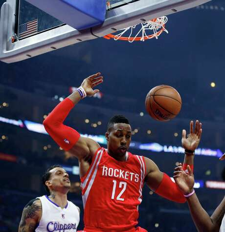 Rockets center Dwight Howard got going early in Game 6 of the Western Conference semifinals, throwing down a dunk in the first quarter of Thursday night's game at Staples Center in Los Angeles. Photo: James Nielsen, Staff / © 2015  Houston Chronicle