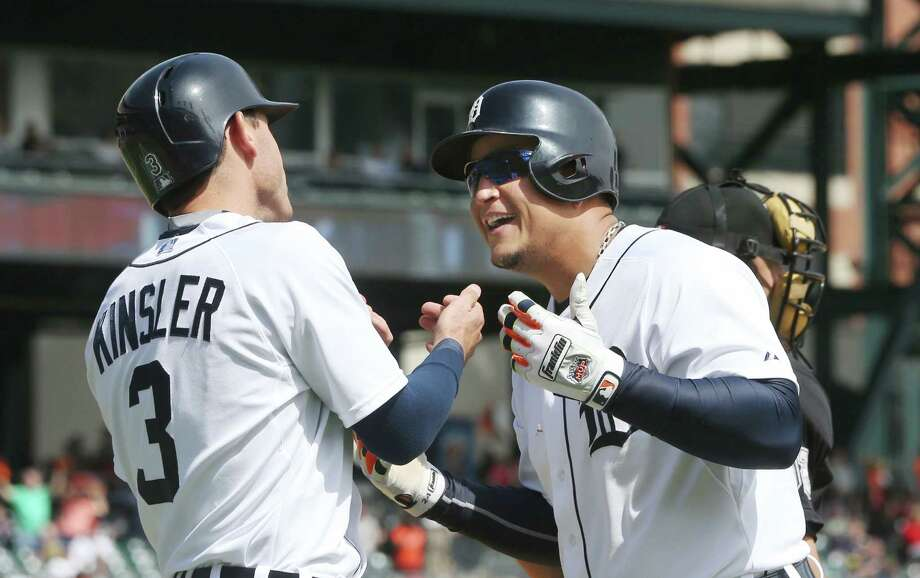 Detroit Tigers' Miguel Cabrera and Ian Kinsler celebrate Cabrera's two-run home during the seventh inning of a baseball game against the Minnesota Twins, Thursday, May 14, 2015, in Detroit. (AP Photo/Carlos Osorio) Photo: Carlos Osorio, STF / AP