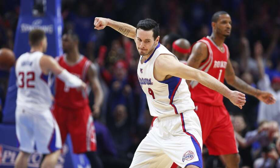Los Angeles Clippers guard J.J. Redick (4) reacts to hitting a 3-pointer against the Houston Rockets during the first half of Game 6 of the NBA Western Conference semifinals at the Staples Center Thursday, May 14, 2015, in Los Angeles.  ( James Nielsen / Houston Chronicle ) Photo: Houston Chronicle