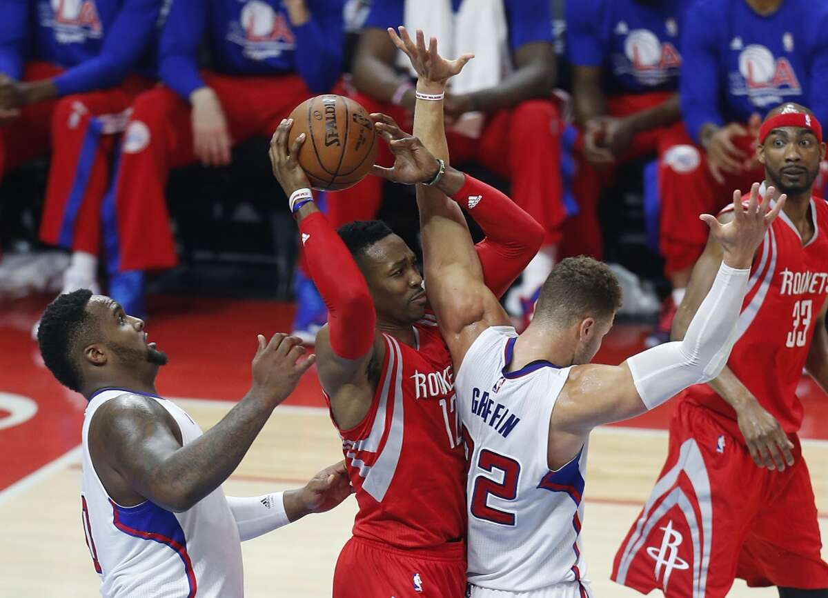 Houston Rockets center Dwight Howard (12) is surrounded by Los Angeles Clippers forward Glen Davis (0) and forward Blake Griffin (32) as he looks to pass the ball during the first half of Game 6 of the NBA Western Conference semifinals at Staples Center on Thursday, May 14, 2015, in Los Angeles. ( Karen Warren / Houston Chronicle )