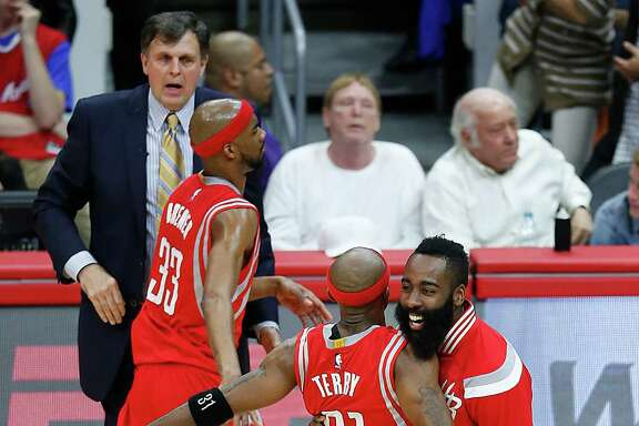Houston Rockets guard Jason Terry (31) and guard James Harden (13) embrace during a time out against the Los Angeles Clippers during the second half of Game 6 of the NBA Western Conference semifinals at Staples Center on Thursday, May 14, 2015, in Los Angeles.  ( Karen Warren / Houston Chronicle  )
