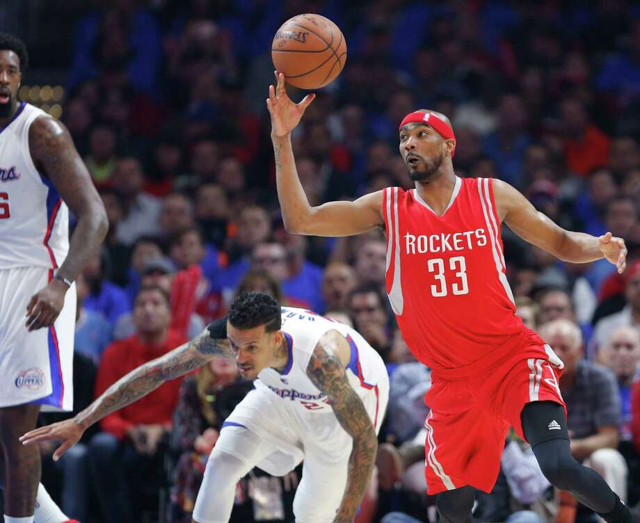 Corey Brewer, right, became one of the Rockets' fourth-quarter stars as he had Matt Barnes and his Clippers teammates stumbling, crumbling and fumbling down the stretch Thursday night. Photo: James Nielsen, Staff / © 2015  Houston Chronicle