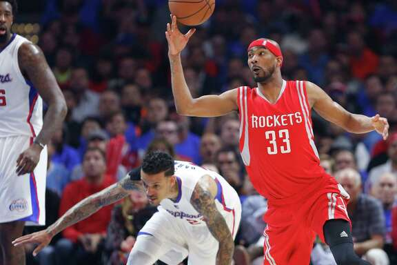 Corey Brewer, right, became one of the Rockets' fourth-quarter stars as he had Matt Barnes and his Clippers teammates stumbling, crumbling and fumbling down the stretch Thursday night.