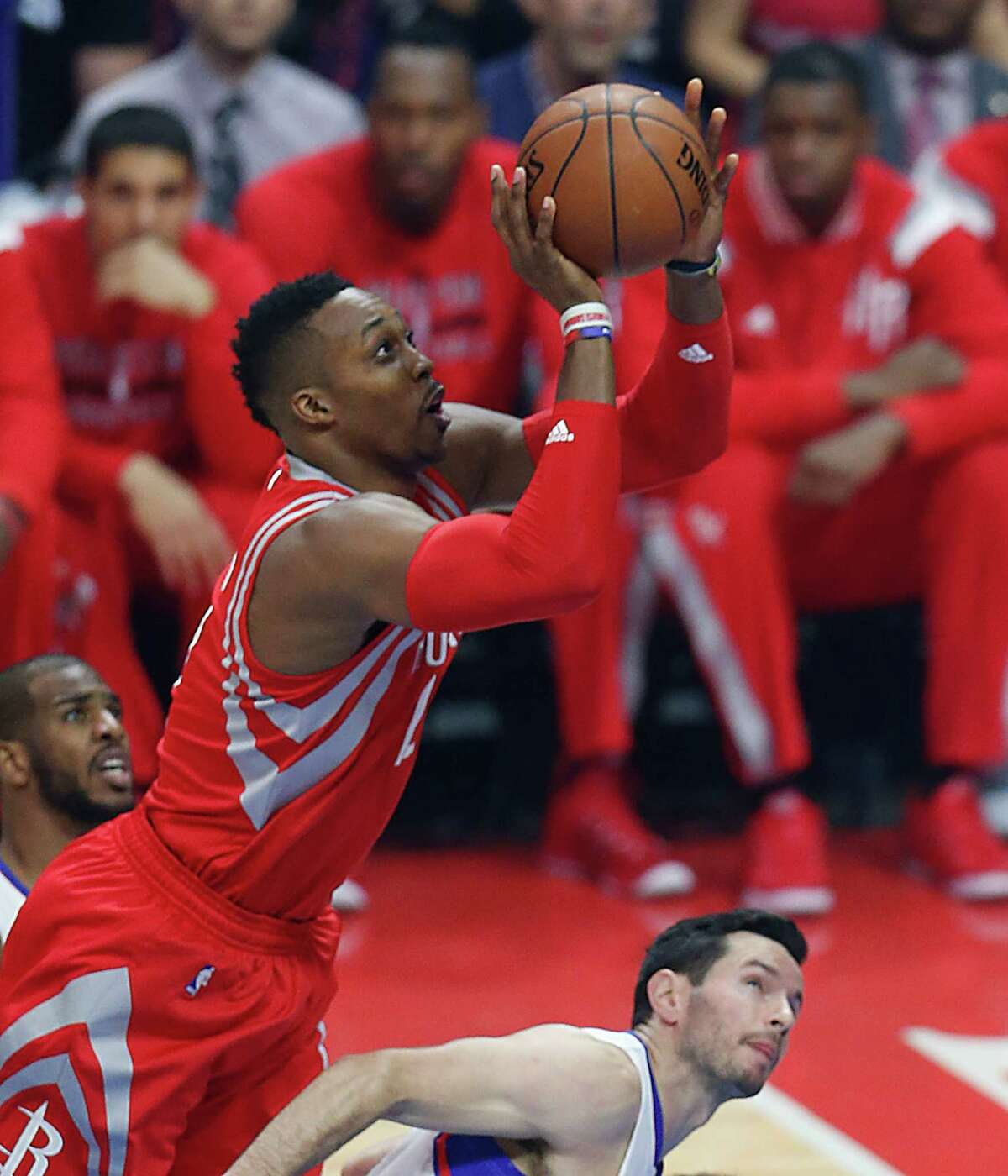 Rockets center Dwight Howard puts up a shot over Clippers guard J.J. Redick on his way to 20 points.