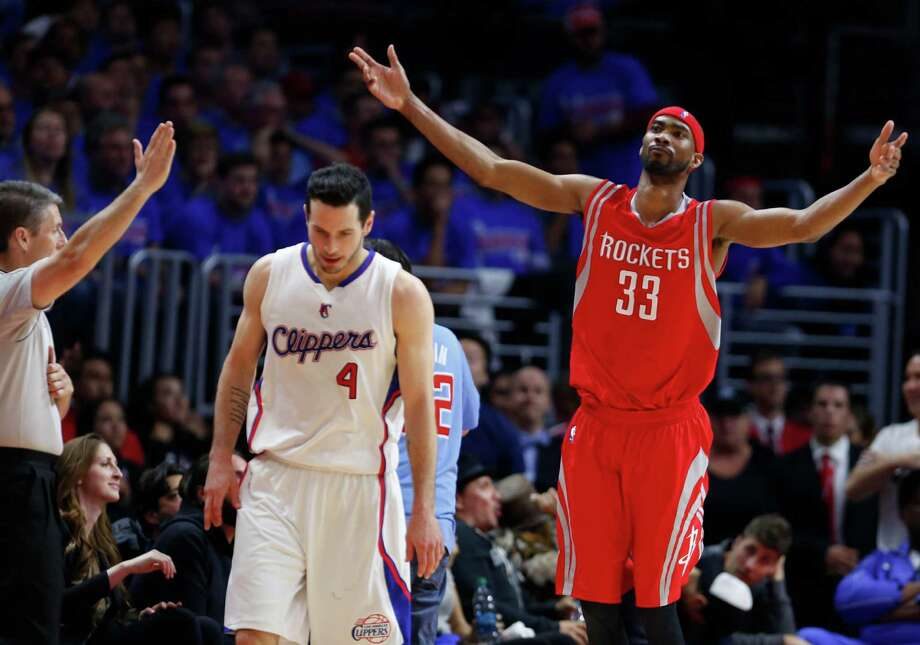 The Rockets' Corey Brewer (33) and the Clippers' J.J. Redick reflect the strange turn of events in the fourth quarter Thursday night. Photo: James Nielsen, Staff / © 2015  Houston Chronicle
