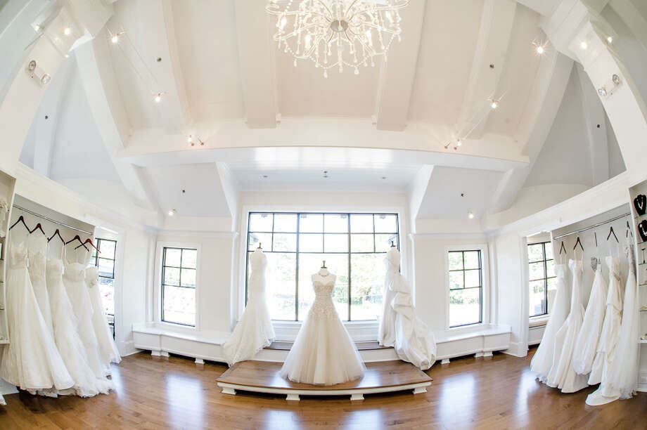 Wedding spending nationally topped a record $31,000 on average last year, according to The Knot, a website that surveyed some 16,000 brides and grooms that use its website last year. With brides often planning upscale weddings in Southwest Connecticut, that could add up to a big 2015 season for shops like A Little Something White in Darien, Conn. Photo: Contributed Photo, Contributed / Darien News