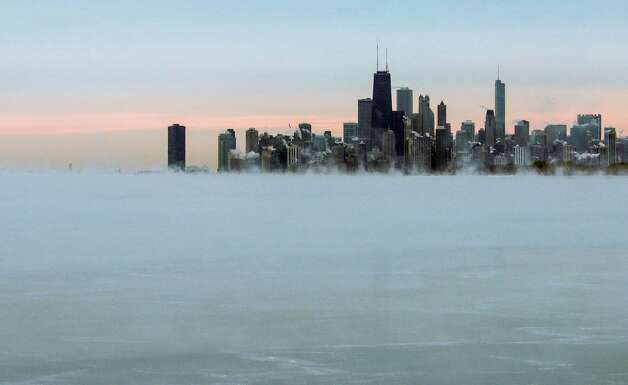 Steam rises on Thursday from Lake Michigan near Chicago's skyline. Natural gas inventories have declined as wintry weather makes its mark in the U.S., but the drawdown last week was less than the five-year average. Photo: Teresa Crawford, STF / AP