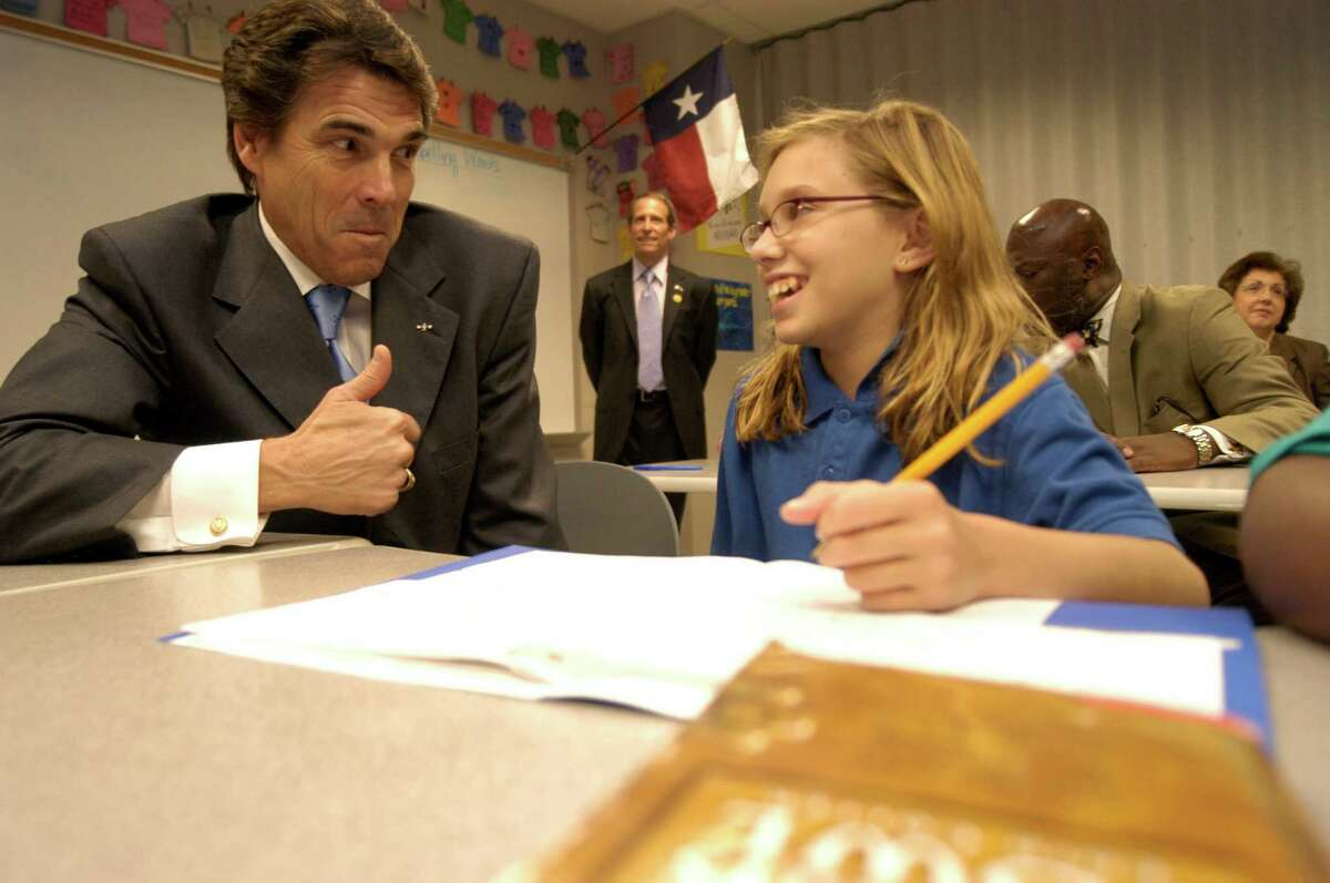 Ariadne Frolich, 11, a student from New Orleans gets a thumbs up from Texas Gov. Rick Perry during her sixth grade class at Pin Oak Middle School Friday, September 16, 2005. Perry along with U.S. Secretary of Education, Margaret Spellings(not pictured) and Texas Commissioner of Education Shirley Neeley (not pictured) visited classrooms at Pin Oak Middle School and held a press conference afterward where Spellings confirmed that Houston's education will receive federal funding for taking in evacuated children from Louisiana, as well special funding will be given to those children who have been displaced. Johnny Hanson Chronicle