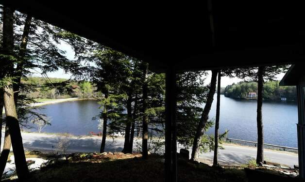 Looking out over Lake Desolation from the front porch at 709 Lake Desolation Road Monday morning May 11, 2015 in the Town of Greenfield, N.Y.        (Skip Dickstein/Times Union) Photo: SKIP DICKSTEIN / 00031686A