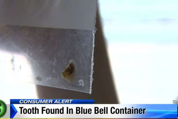 A Houston family claims they found this tooth inside a carton of Blue Bell Cookies 'n Cream ice cream in March.