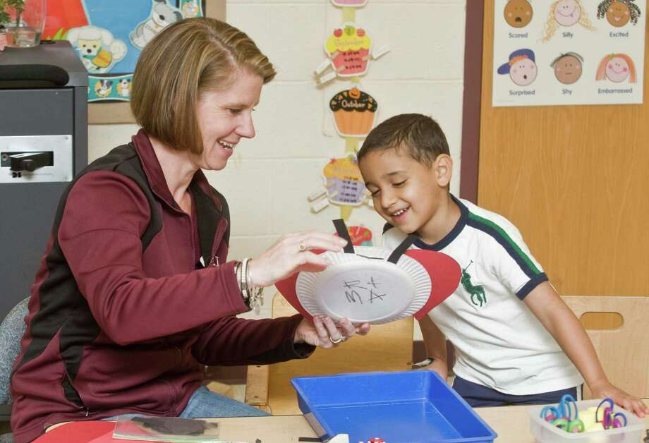 Special Ed. substitute teacher Mary Beth Cooke works with five-year-old Quinn Osimanti in the preschool classroom at the Frank A. Berry School in Bethel. Friday, May 15, 2015 Photo: Scott Mullin / The News-Times Freelance