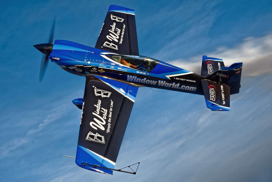 Stunt pilot Rob Holland showing off the sponsorship logos for Window World. The window replacement company, which has a location in Manchester, is a sponsor of the Great New England Airshow, taking place May 16 & 17 in Chicopee, Massachusetts. Photo: Steven E. Serdikoff/Contributed / Steven E. Serdikoff Connecticut Post contributed