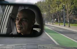 Sidecar co-founder and CEO Sunil Paul drives a customer down the Embarcadero in San Francisco, Calif. Friday, May 15, 2015. Paul regularly works as a driver, picking up passengers on his way to the Sidecar office where he runs the company.