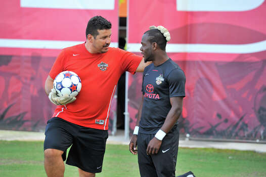 Scorpions Billy Forbes talks with goal keeper coach Juan Lamadrid.