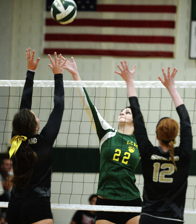 Little Cypress-Mauriceville's Sarah Woods (22), will get the opportunity to play volleyball on the collegiate level after signing with the University of Louisiana at Monroe Thursday. Little Cypress-Mauriceville's Sarah Woods, No. 22, pops the ball above Nederland defenders during Tuesday's match. The Nederland High School volleyball team played against Little Cypress-Mauriceville at Little Cypress-Mauriceville on Tuesday afternoon. Photo taken Tuesday 8/26/14 Jake Daniels/@JakeD_in_SETX   Manditory Credit, No Sales, Mags Out, TV OUT, Web: AP Members Only Photo: Jake Daniels / ©2014 The Beaumont Enterprise/Jake Daniels