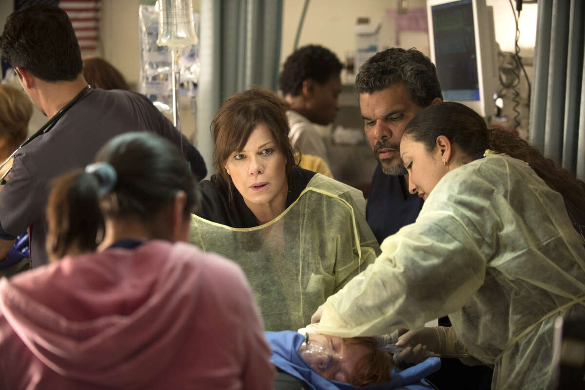 Marcia Gay Harden, center, stars as a surgeon and residency director in