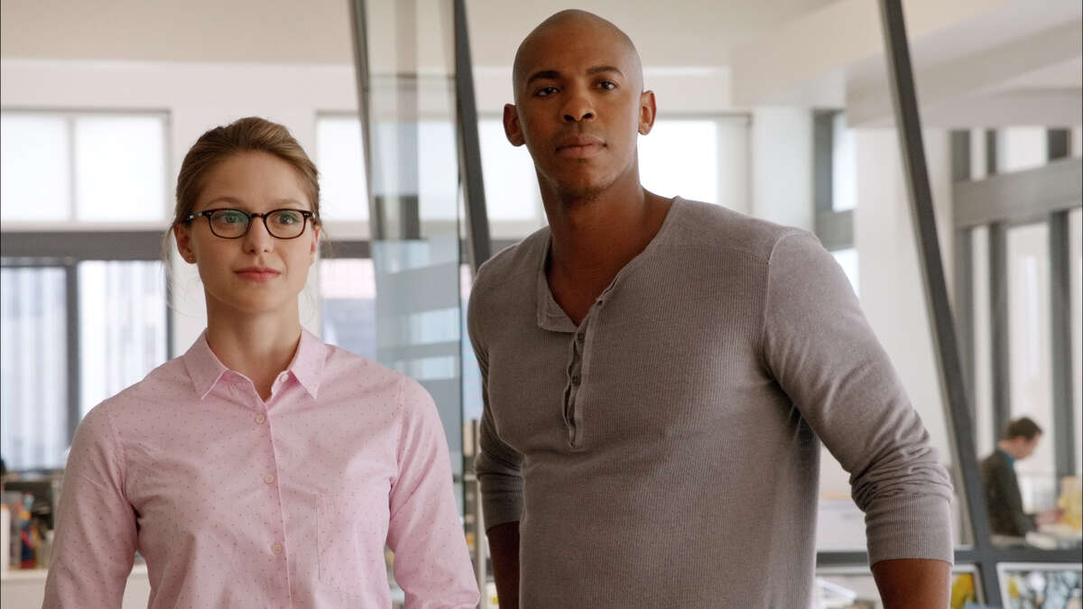 This image from video released by CBS shows Melissa Benoist, left, and Mehcad Brooks in a scene from
