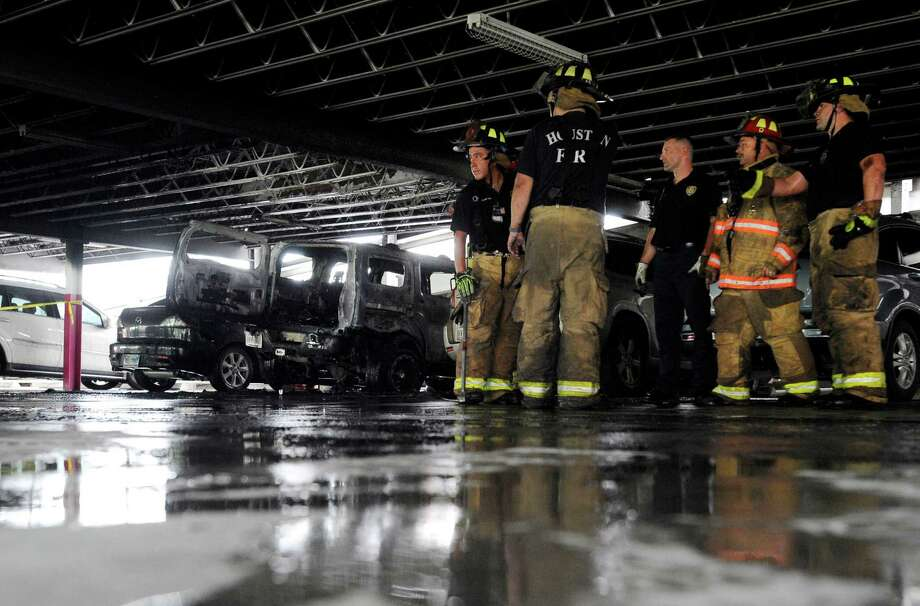Firefighters work to extinguish a three-car fire in a parking garage located at the intersection of Elgin Street and Milam Street Friday, May 15, 2015, in Houston. Photo: Jon Shapley, Houston Chronicle / © 2015 Houston Chronicle
