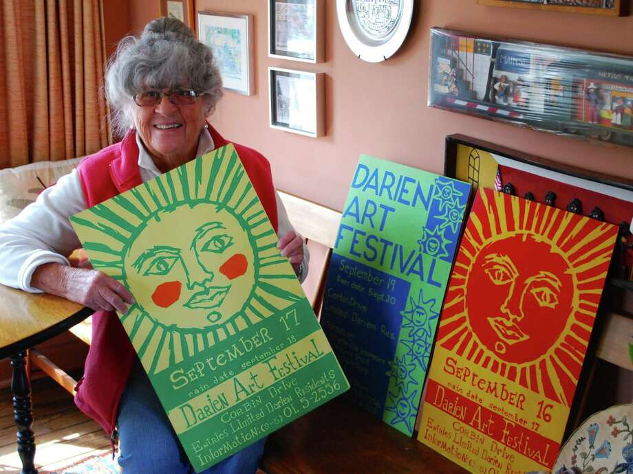 Pat Atkin shows some of the original silk-screened posters she created for the early years of the Darien Art Show and Sale, then called the Darien Art Festival. The 57th version of the event will be Saturday, May 30, to Saturday, June 6, at the Darien Arts Center Weathertone Studio. Photo: Contributed Photo / Stamford Advocate Contributed photo