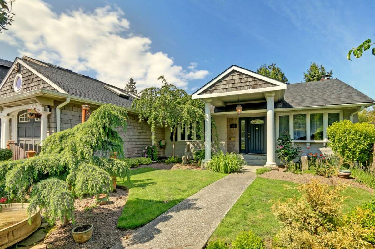 The first home, 6412 N.E. 60th St., is listed for $898,000. The four bedroom, two bathroom home features a beautifully landscaped English garden and a small potting shed. This home will host an open house Sunday, May 17 from 1 - 4 p.m. See the full listing here.