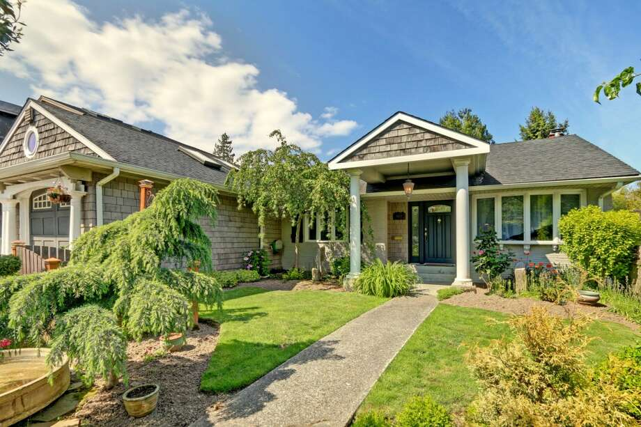 The first home, 6412 N.E. 60th St., is listed for $898,000. The four bedroom, two bathroom home features a beautifully landscaped English garden and a small potting shed.   This home will host an open house Sunday, May 17 from 1 - 4 p.m. See the full listing here. Photo: Frank Jenkins/Vista Estate Imaging