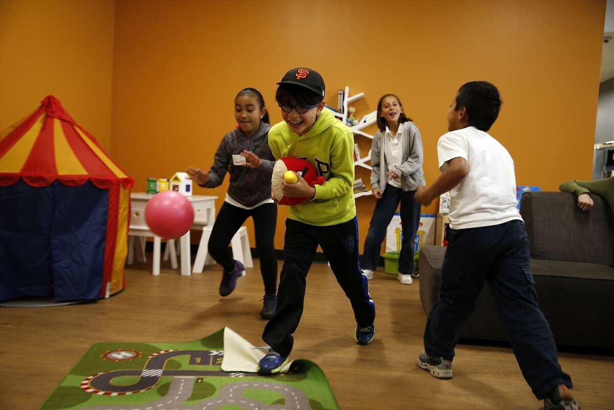 (left to right) Jacqueline Moreno, 10; Diego Castro, 9; Alex Sanchez, 10; and Miguel Sauer, 8; play in the living room at Twitter's NeighborNest before taking a Coding for Kids' class in San Francisco, Calif., on Thursday, May 14, 2015.