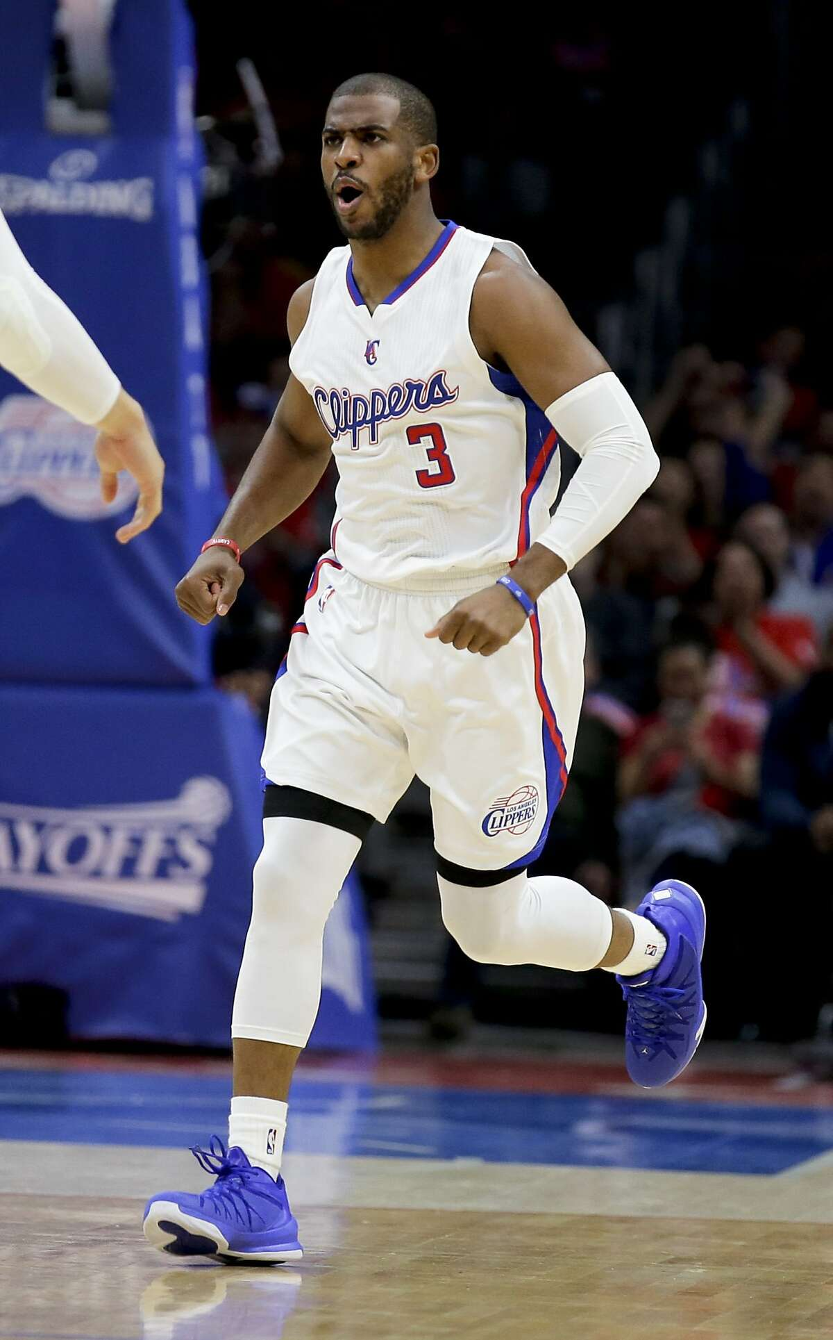 Los Angeles Clippers guard Chris Paul celebrates during Game 2 of a first-round NBA basketball playoff series against the San Antonio Spurs in Los Angeles, Thursday, April 23, 2015. The Spurs won 111-107 in overtime. (AP Photo/Chris Carlson)
